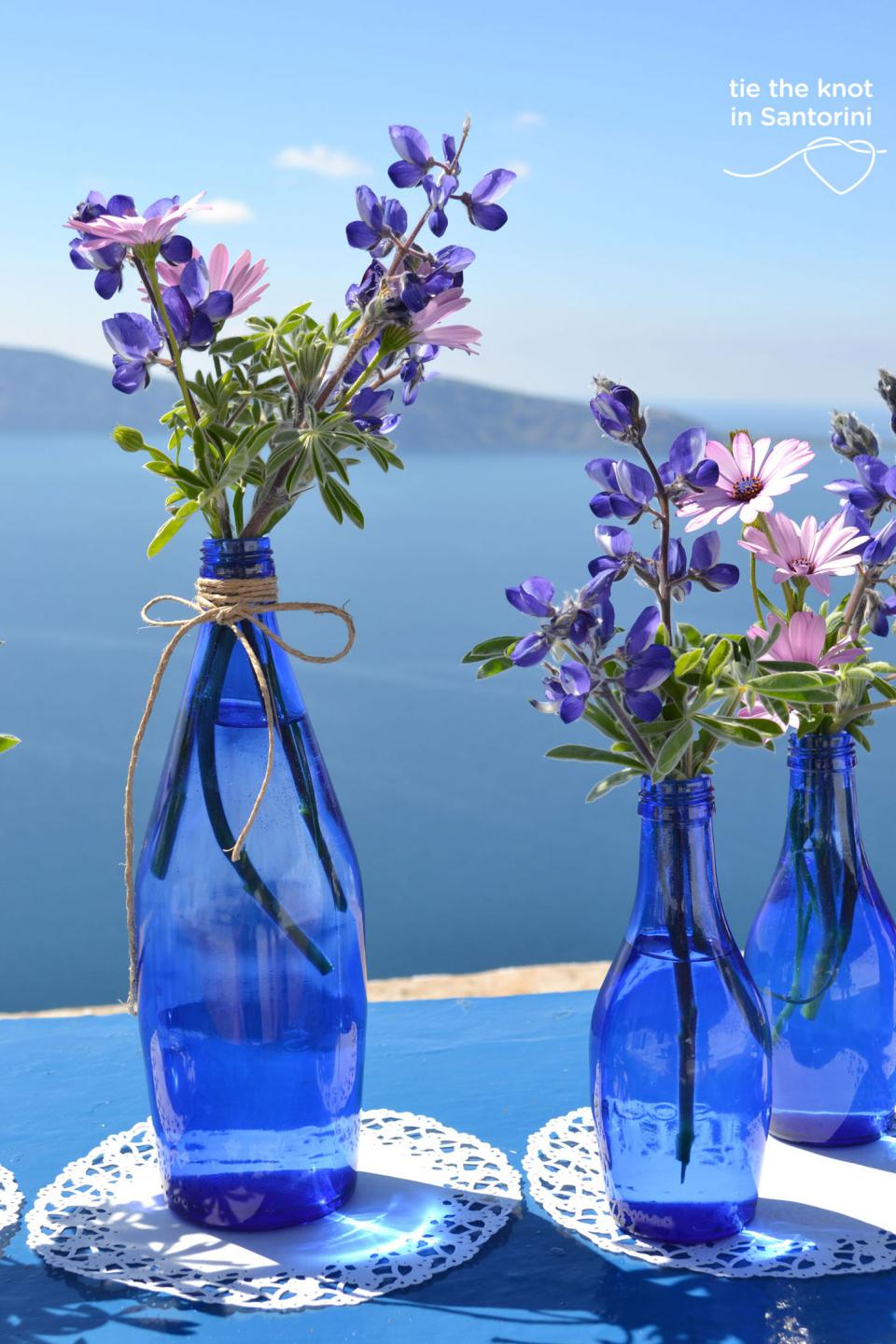 Diy santorini wedding decor in blue purple tie the knot