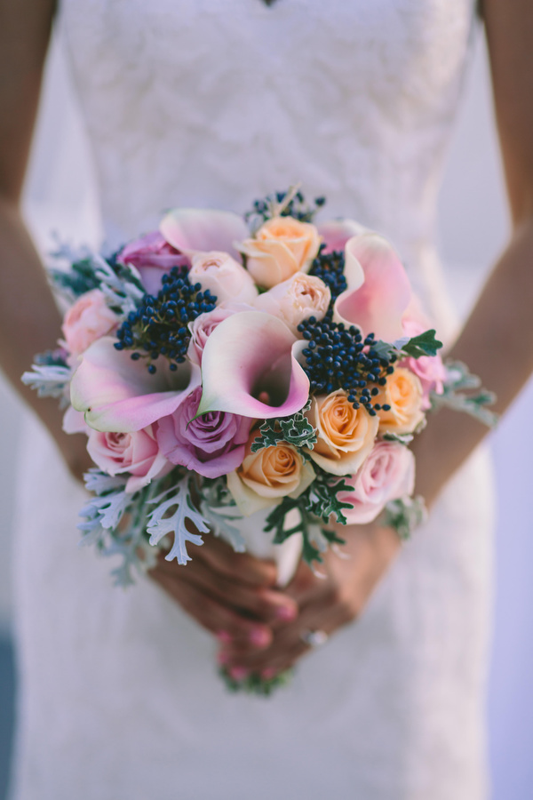 Calla lilies and roses bouquet in lilac and peach tones