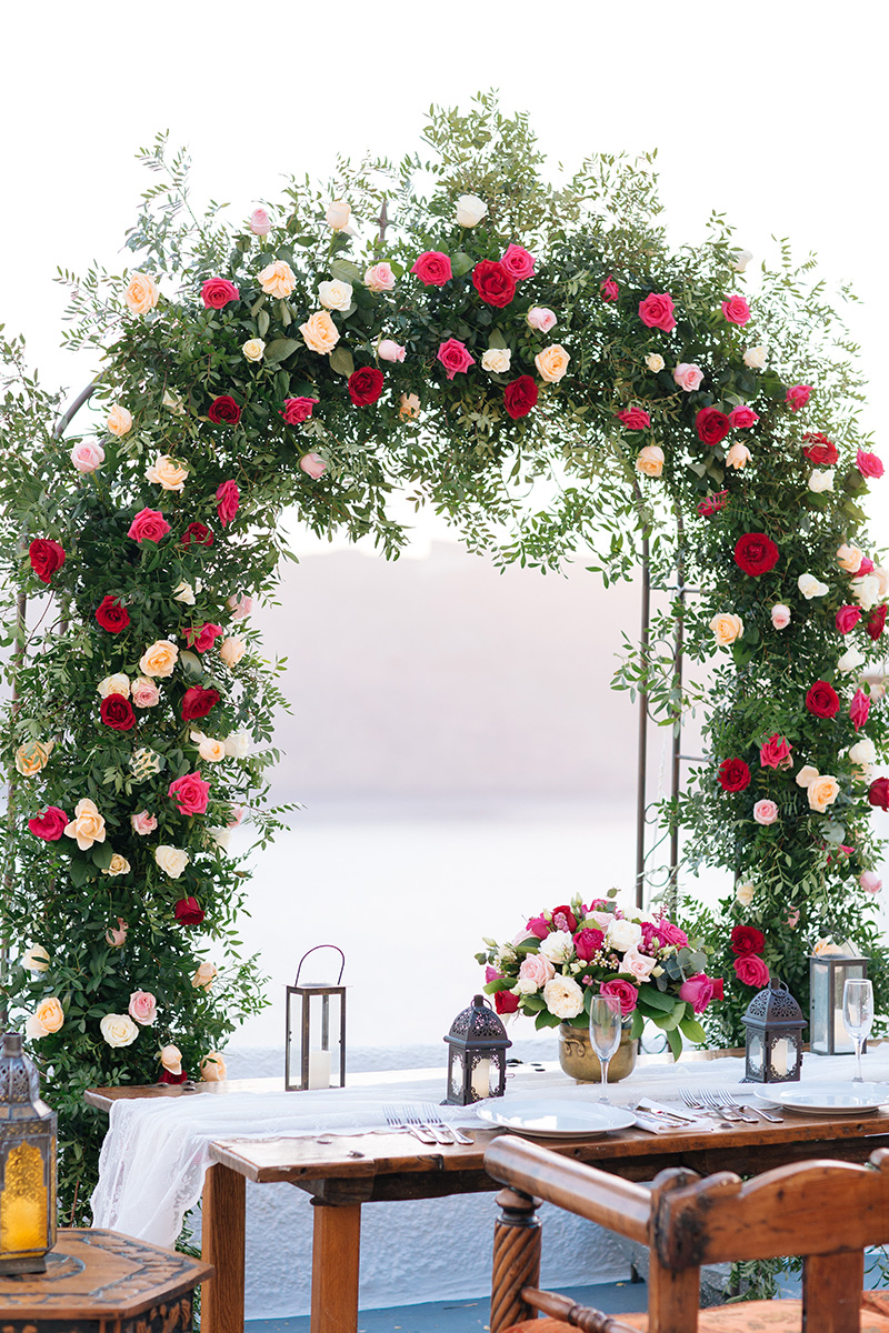 Lush flower arch-Santorini wedding