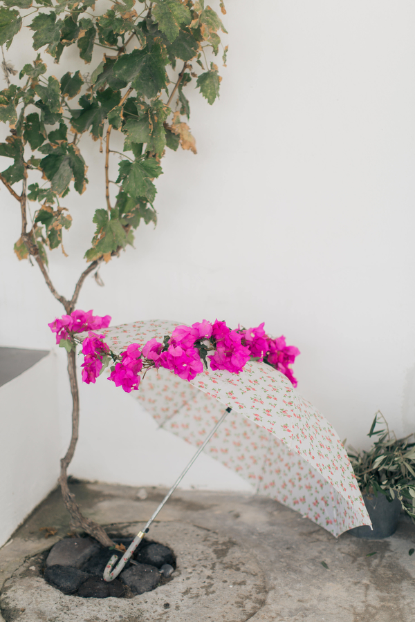 Elegant bougainvillea wedding in the rain