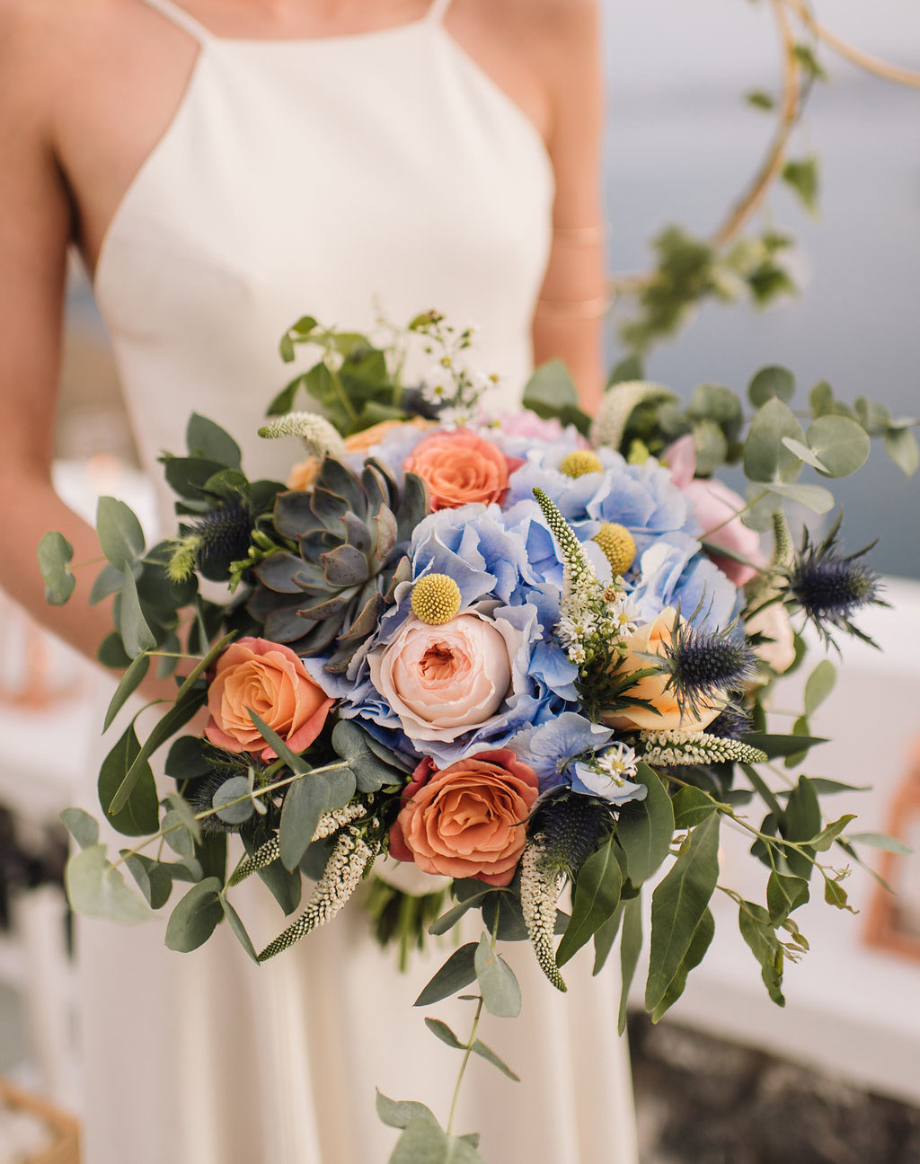 Dusty blue and peach bridal bouquet