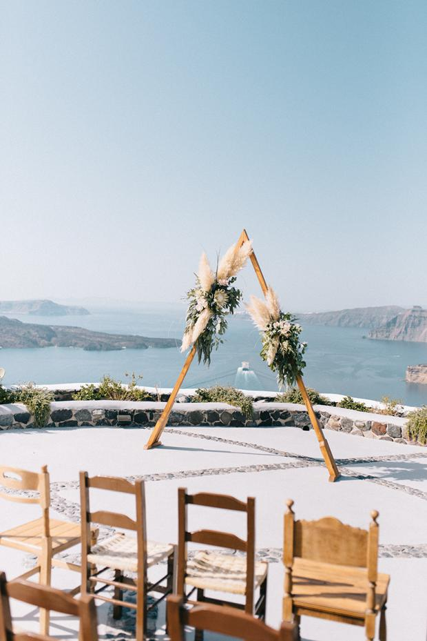 Triangle arch - modern bohemian wedding in Greece