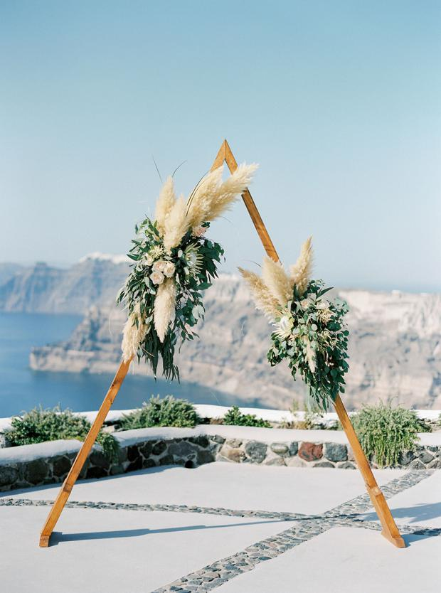 Triangle arch with pampas grass and king proteas- Modern wedding in Greece