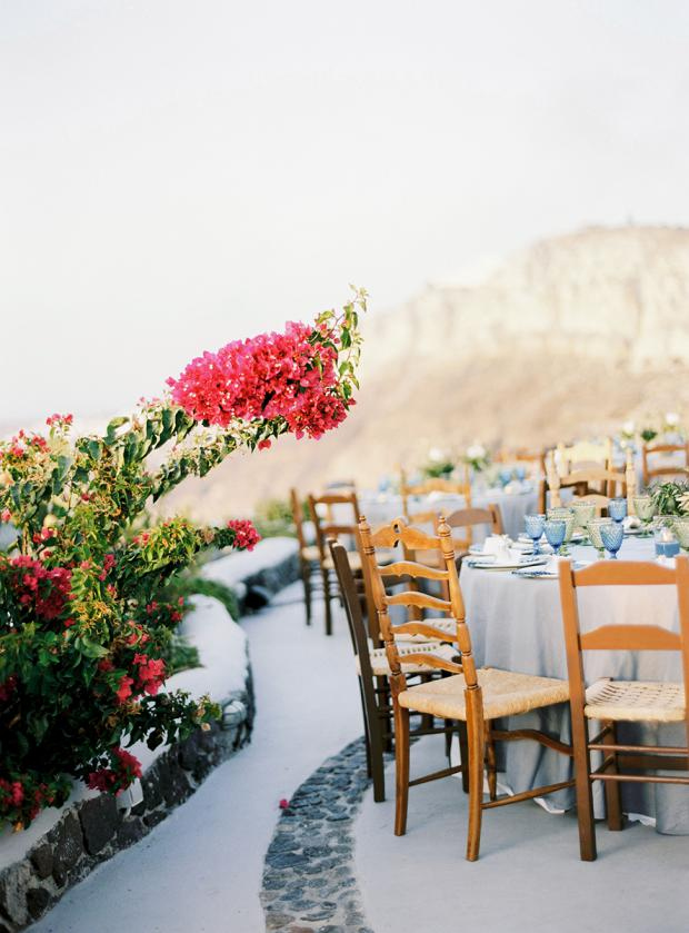 Bohemian wedding  reception in Greece-mismatched chairs