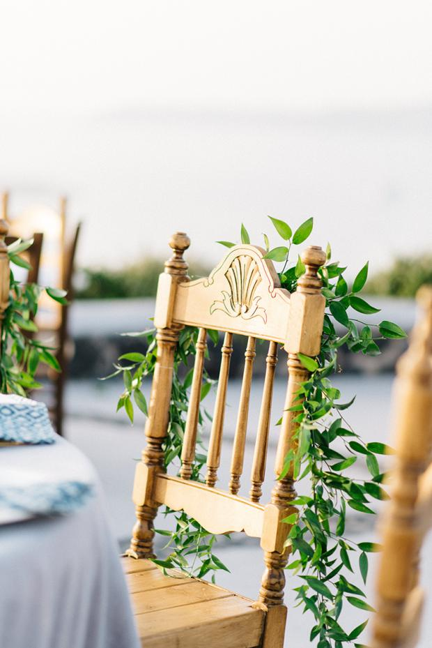 Bohemian wedding  reception in Greece- wooden chairs