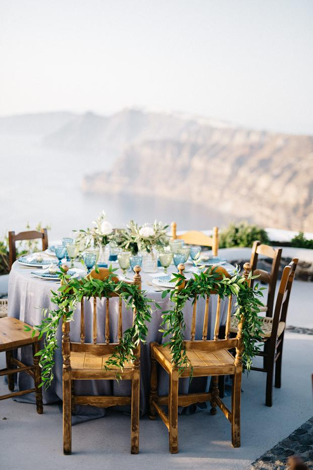 Bride and groom chairs - bohemian wedding in Greece