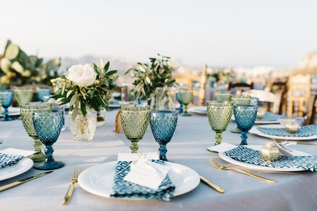 Wedding tablescape in green and blue - colourful glassware  and pattern  napkins