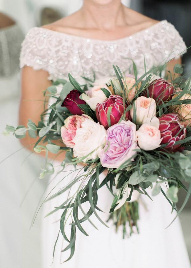 protea and garden roses bouquet