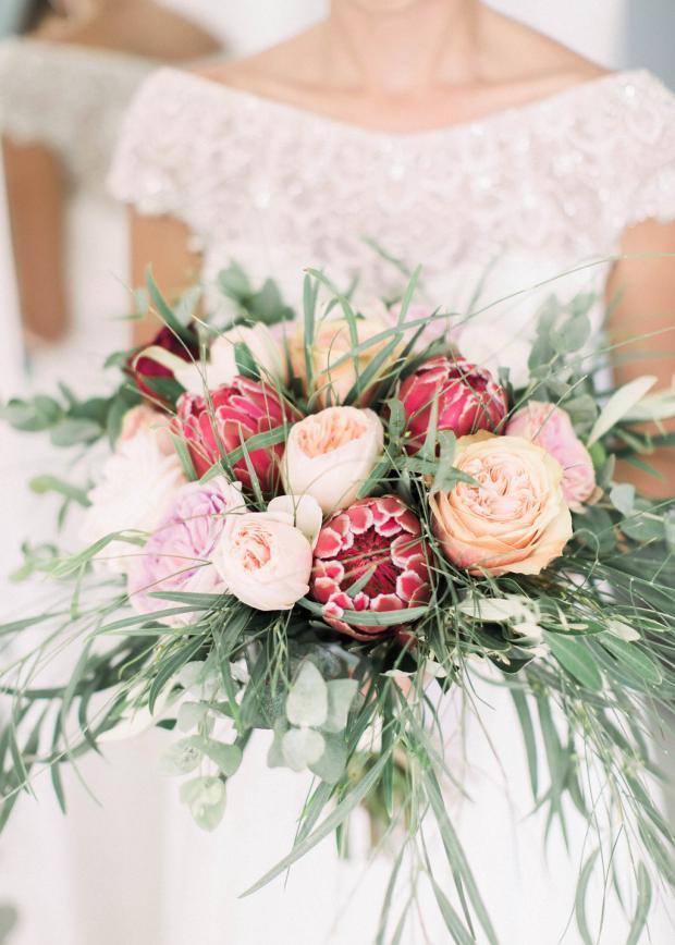 protea and garden roses bouquet