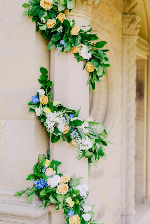 Ceremony arch flower garland in  green, yellow and blue