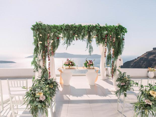 Whimsical, greenery wedding ceremony