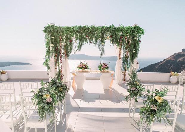 Greenery and flowers wedding aisle