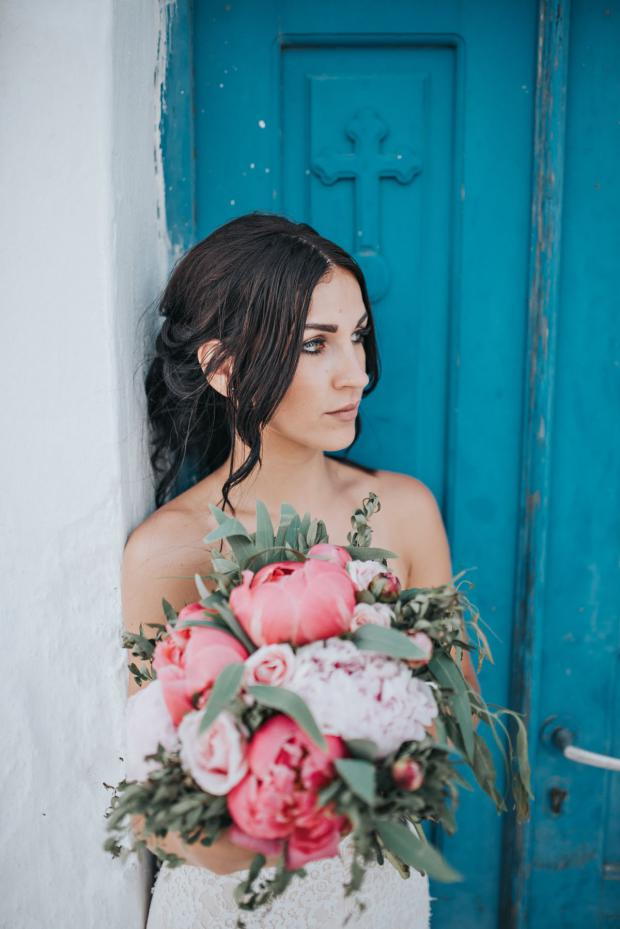 Gorgeous bride and a beautiful peony bouquet
