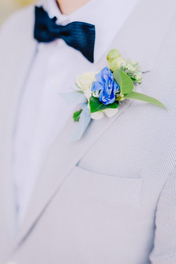 Blue groom boutonniere
