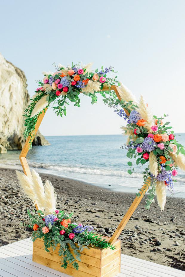 Hexagonal and colourful wedding arch
