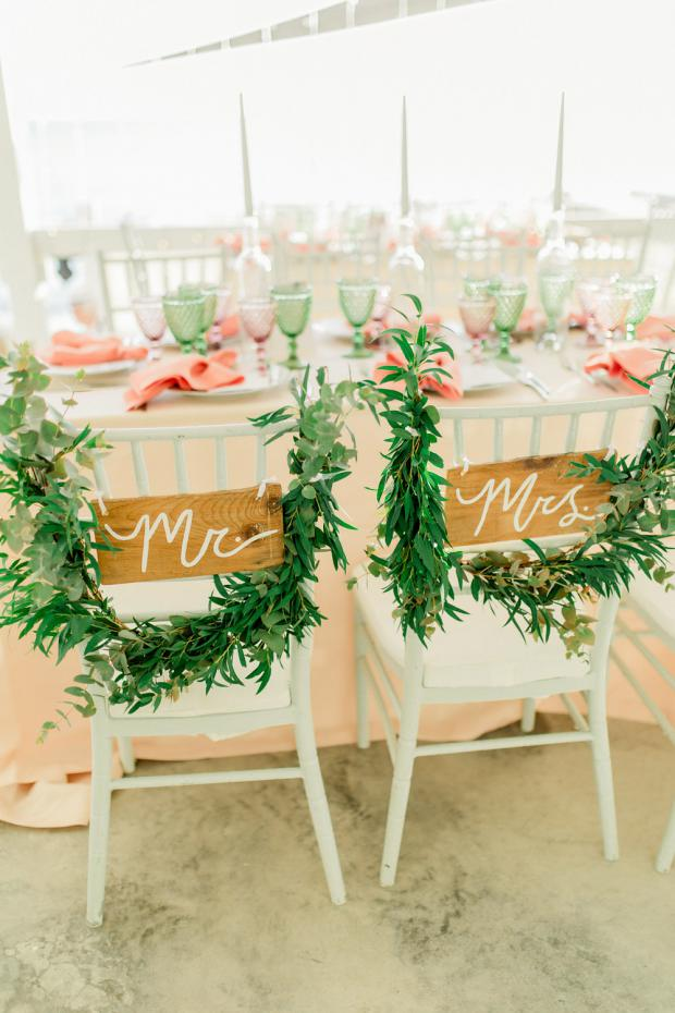 Bride and groom greenery chairs