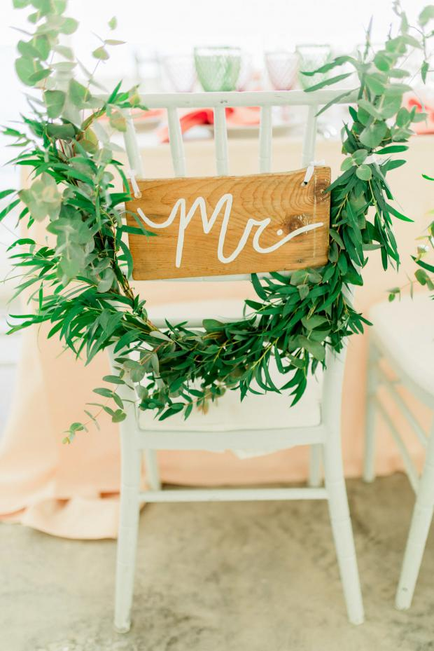 Bride and groom greenery chairs