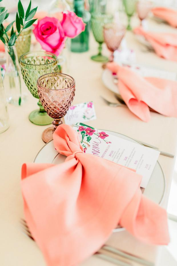 Peach napkins and colourful goblets