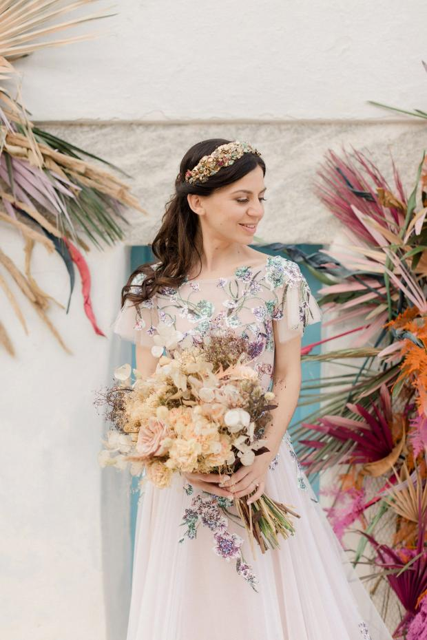 dried flowers bouquet and a sequin floral wedding dress