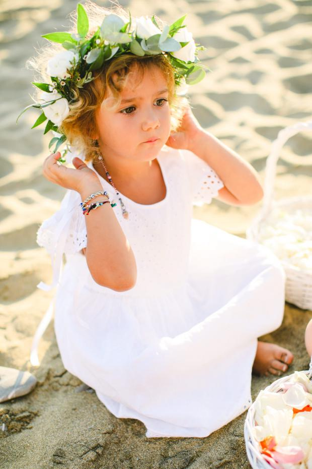 The cutest flower gir - beach wedding in Greece