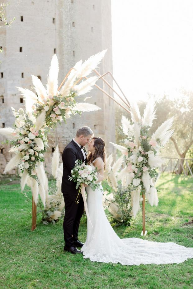 Romantic-modern  ceremony with pampas  at an old castle in Italy