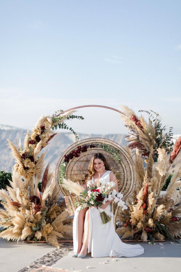 wedding peacock chair and pampas grass