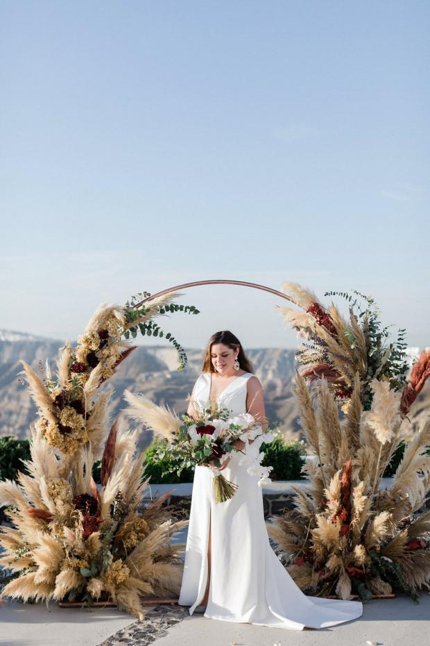 Burgundy pampas and dried flowers arch