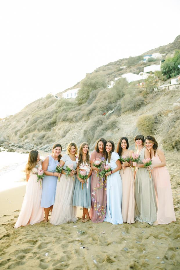 Beach wedding in Greece- Bridesmaids with mismatched dresses