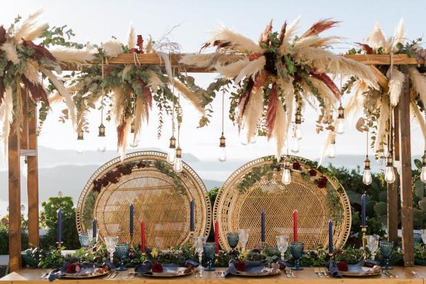 Pampas and peacock chair wedding dinner set up
