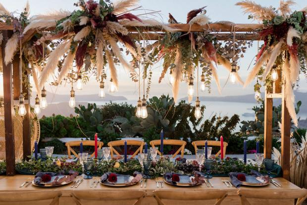 Pampas grass and Edison lamps wedding dinner set up