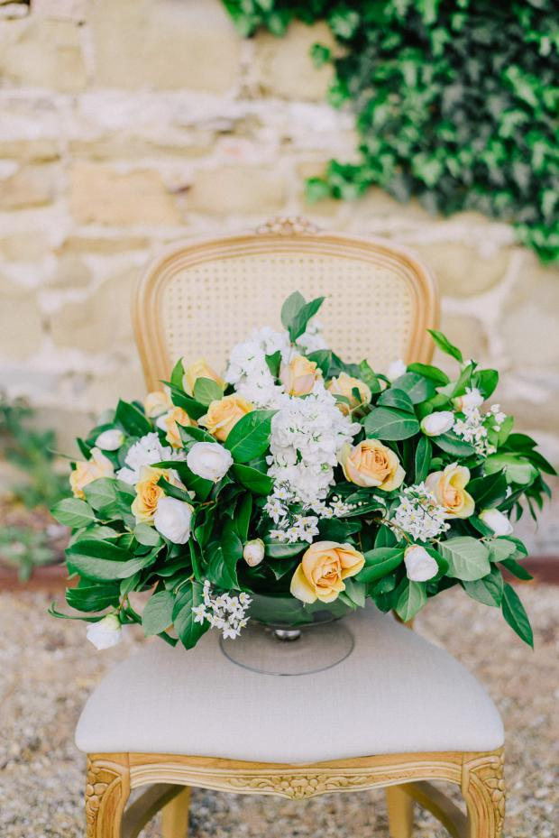 White and yellow centrepiece- Tuscany wedding