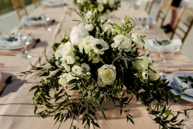 White and greenery centrepiece