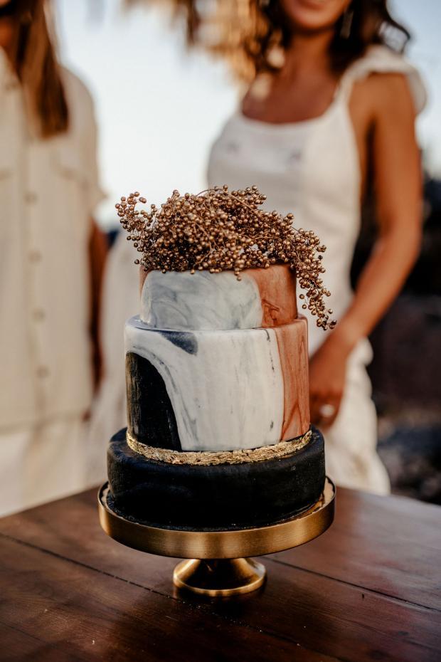 Adventurous elopement in Greece- marble black cake
