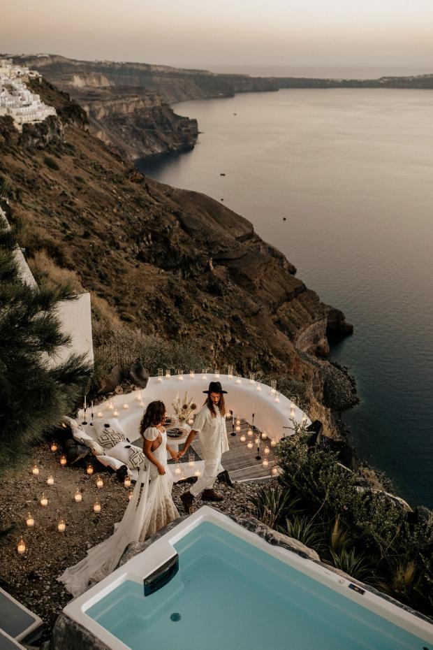 Romantic dinner at a Cycladic balcony in Santorini, Greece