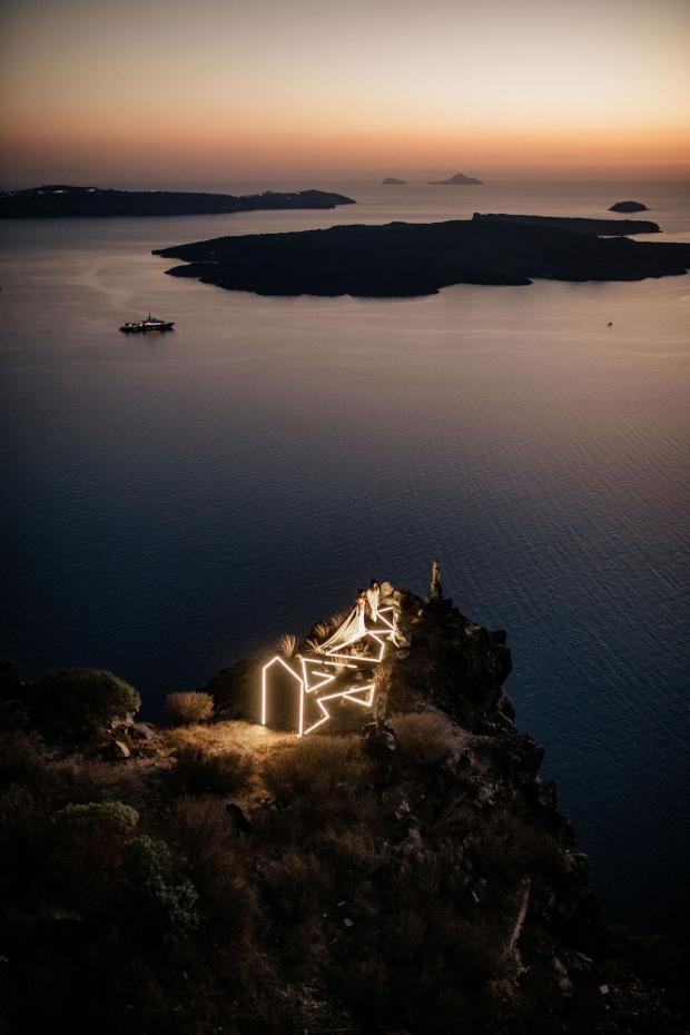 Futuristic elopement in Santorini with LED installation