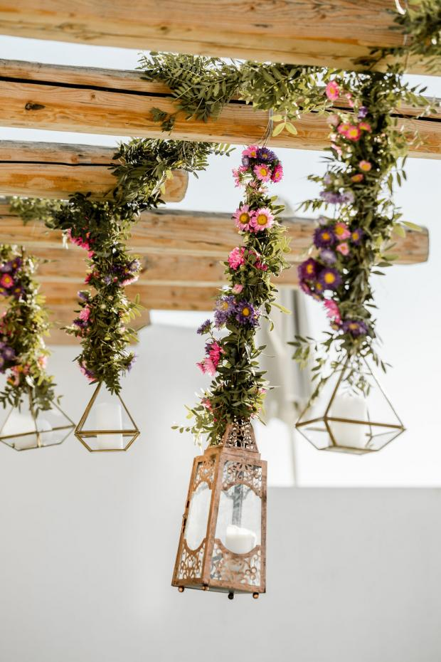 Lanterns with hanging flowers- Whimsical destination wedding