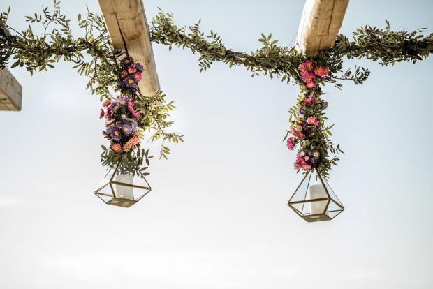Lanterns with hanging flowers- Whimsical destination wedding