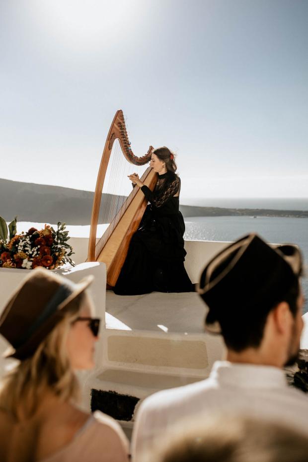 moody santorini wedding - harpist