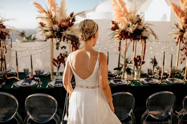 bride admiring dinner table