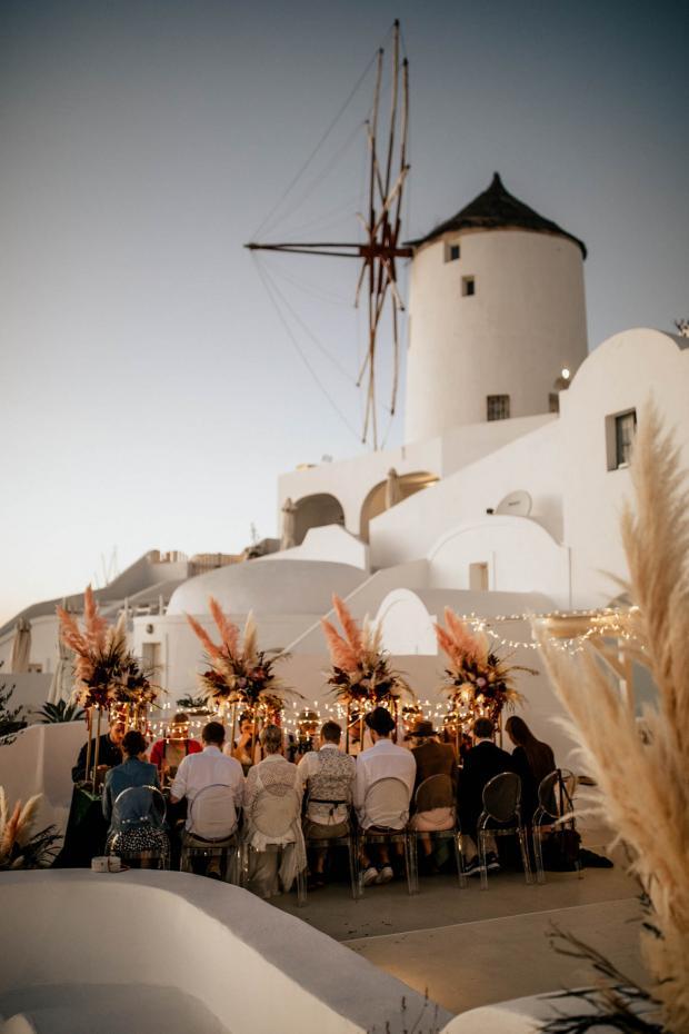 under a windmill wedding in Greece
