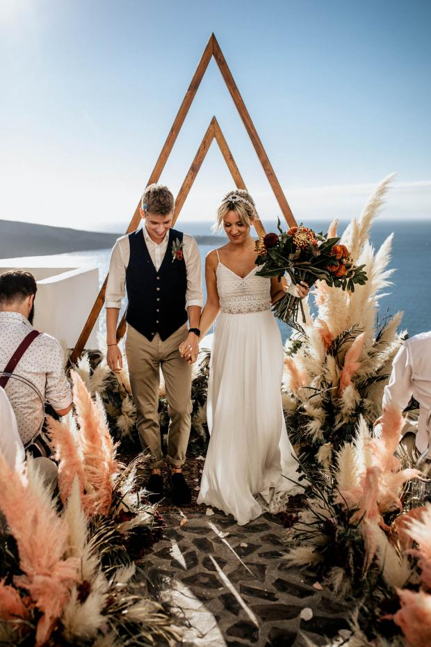 Bohemian Santorini wedding - triangle arch