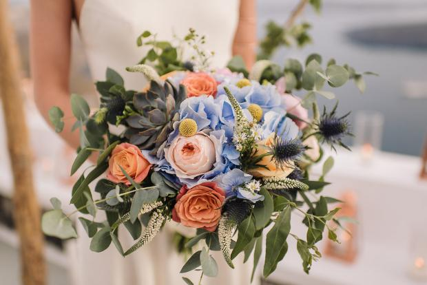 Peach and blue wedding bouquet with  hydrangea and roses