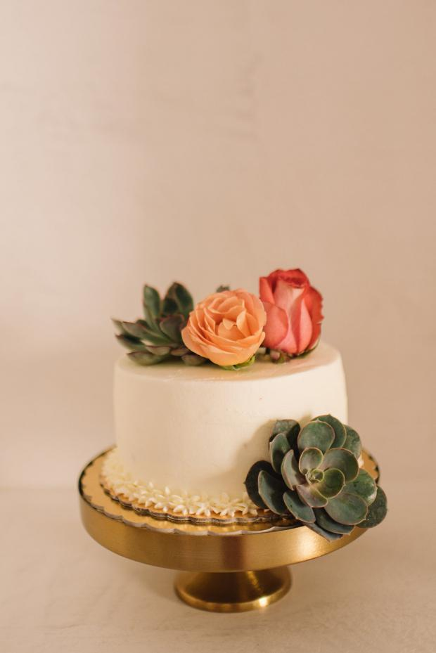 Wedding cake with roses and succulents