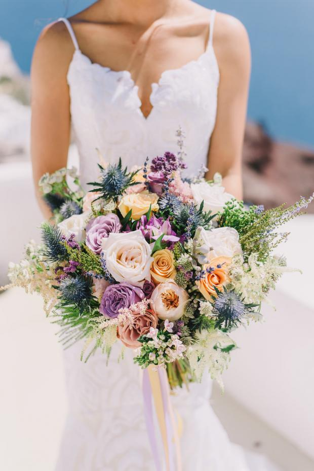 Blue, purple and peach wedding bouquet