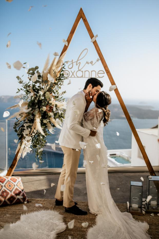 Bohemian & modern wedding in Santorini- triangle arch