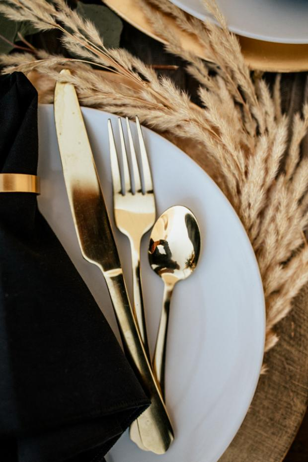 Bohemian and modern wedding dinner- gold and black