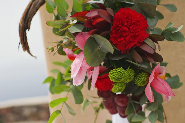 Boho wedding in Santorini-wedding altar details-marsala