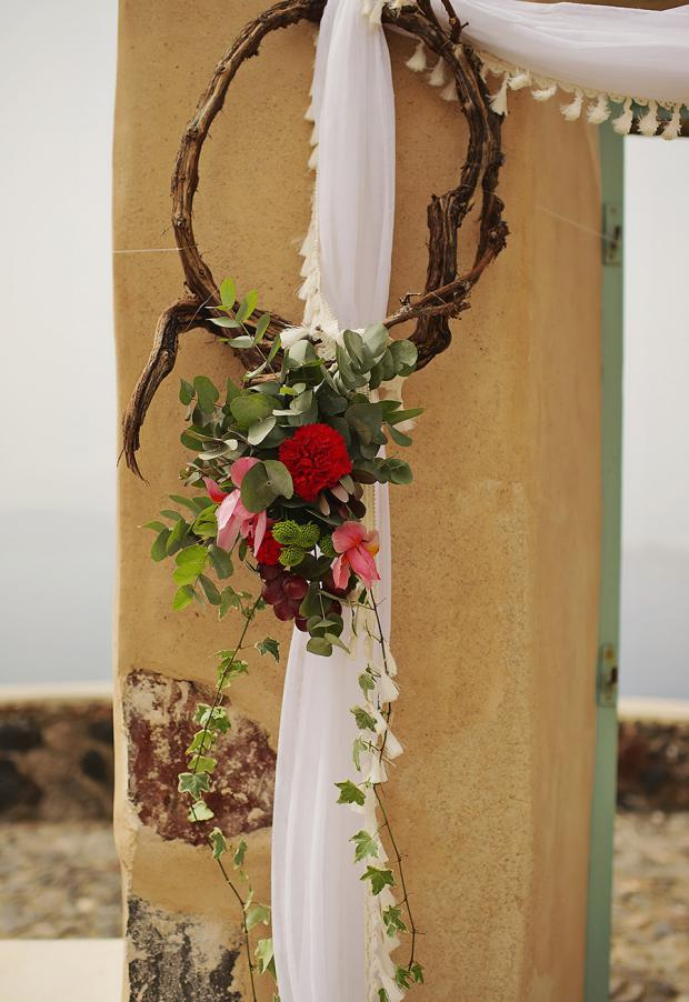 Boho wedding in Santorini- Wedding arch in marsala color