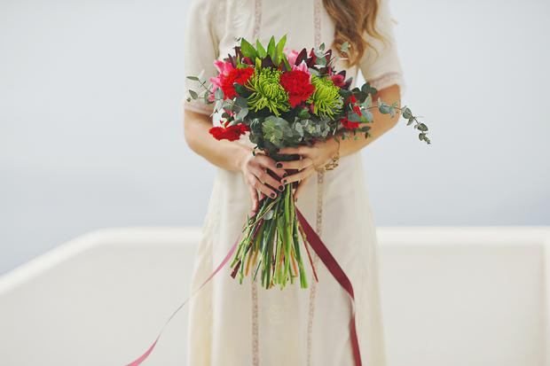 Boho wedding in Santorini- pretty marsala and red  bouquet