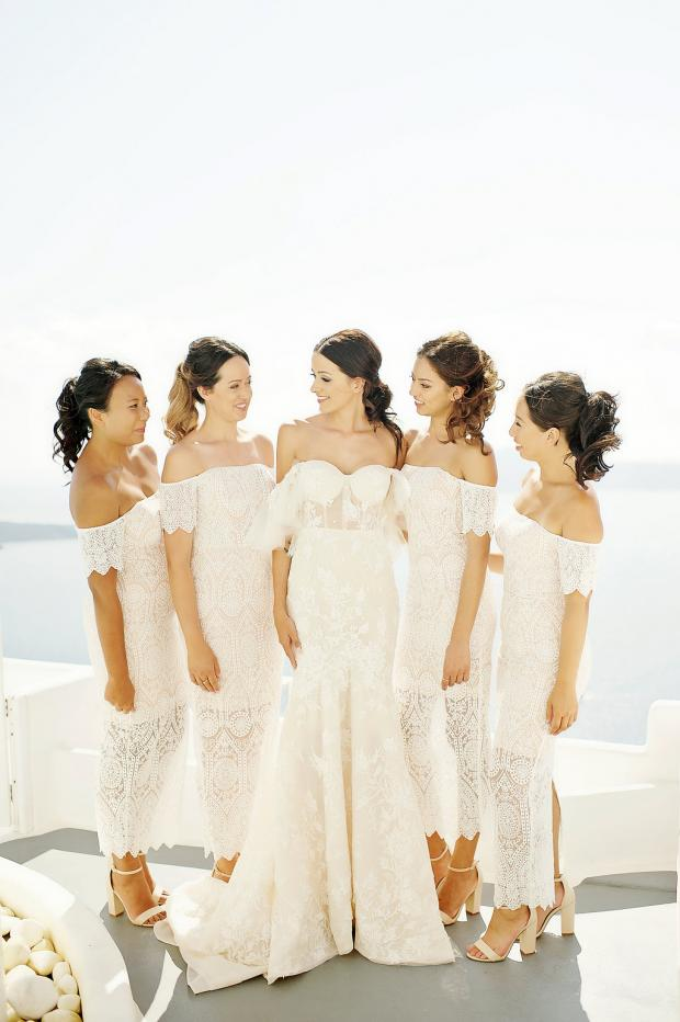Bride in Berta Gown and all white bridesmaids